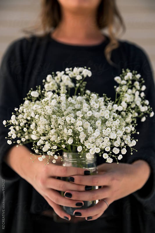 Baby's breath in mason jar. by Robert Zaleski for Stocksy United