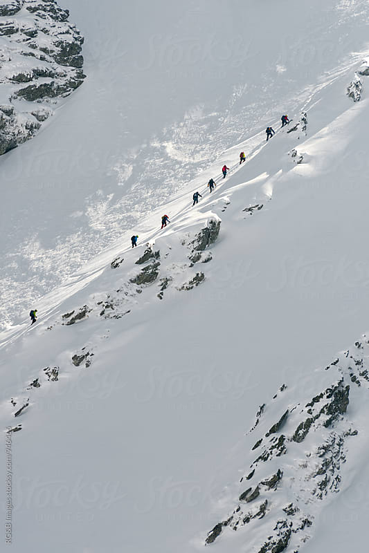 Alpinists climbing the mountain on a light path by RG&B Images for Stocksy United