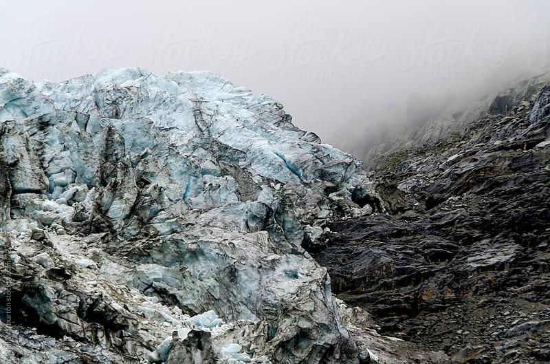 Alpine glacial ice by Neil Warburton for Stocksy United