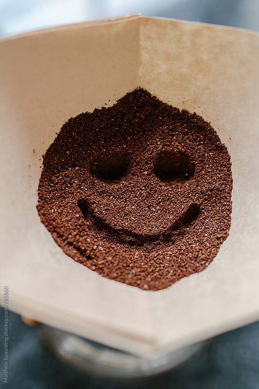 Smiley face in fresh coffee grounds by Matthew Spaulding for Stocksy United