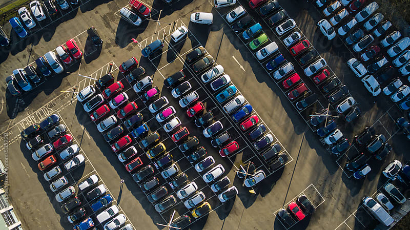 Newly-built cars sit tightly packed awaiting sale by Andy Campbell for Stocksy United