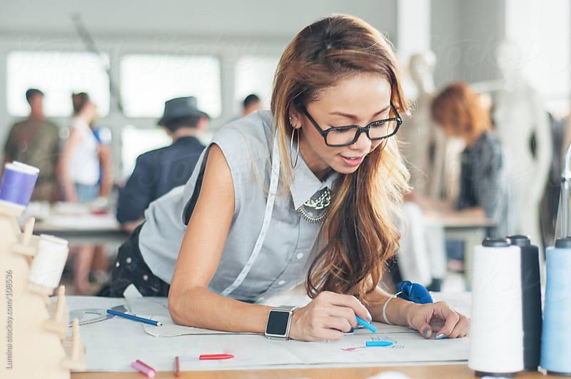 Fashion Designer Sketching by Lumina for Stocksy United