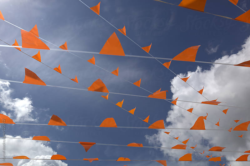 Orange vanes waving in the wind by Marcel for Stocksy United