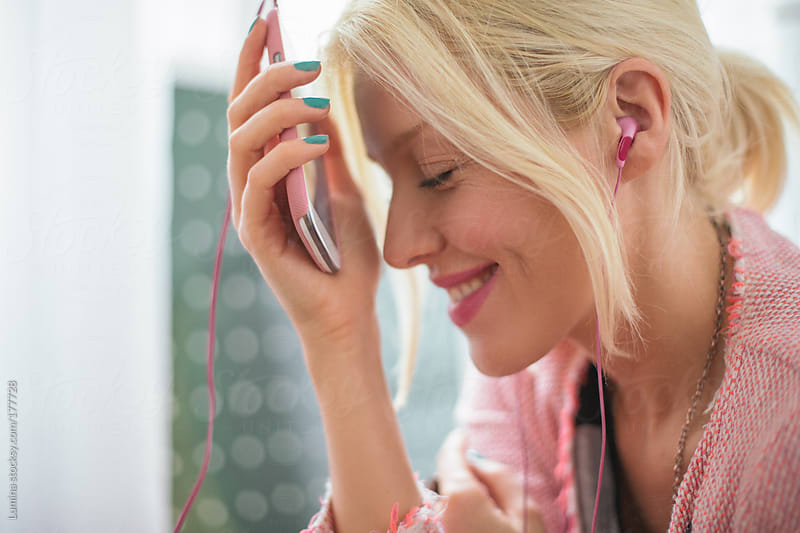Woman Listening to Music on Her Mobile Phone by Lumina for Stocksy United