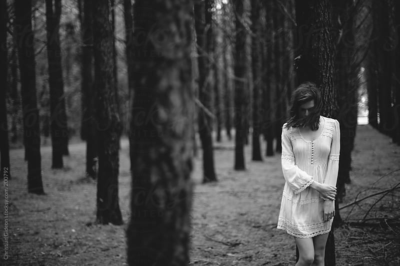 Girl in white dress in pine forest by Christian Gideon for Stocksy United