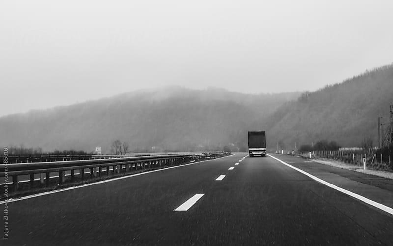 Truck on highway by Tatjana Zlatkovic for Stocksy United