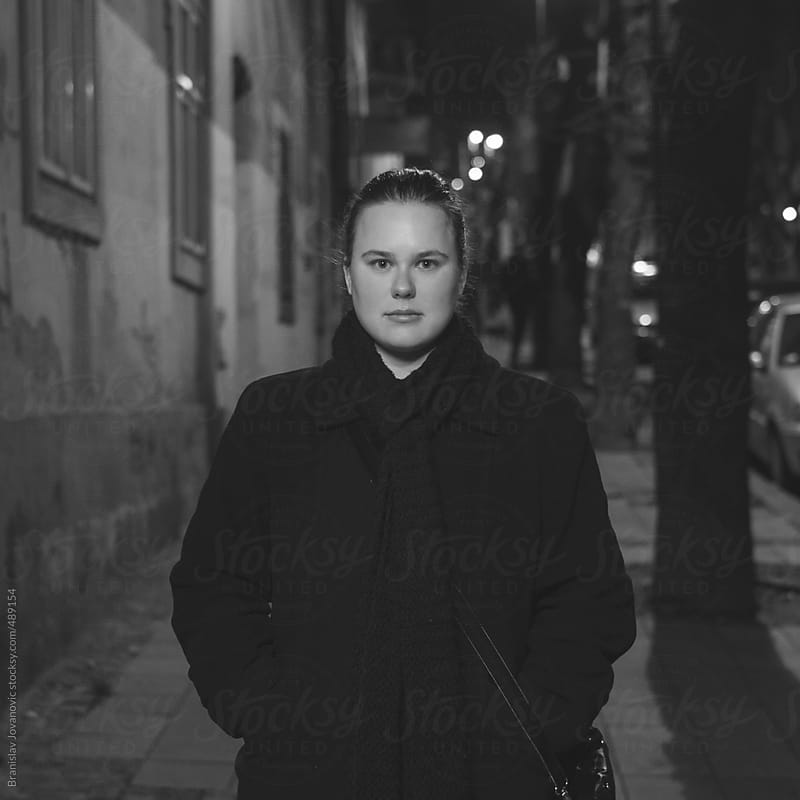 Portrait of a young woman standing on the street by Branislav Jovanović for Stocksy United