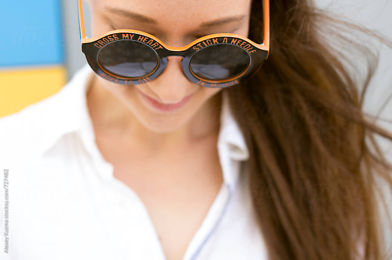 summer portrait of young woman with hat and round sunglasses by Vesna for Stocksy United
