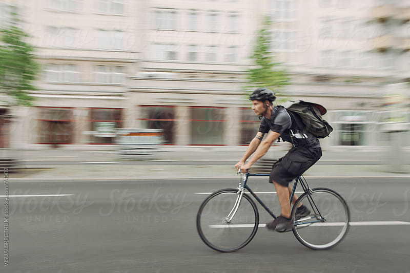 Bicycle Messenger  by VISUALSPECTRUM for Stocksy United