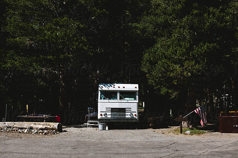 Van in a camping by Simone Becchetti for Stocksy United