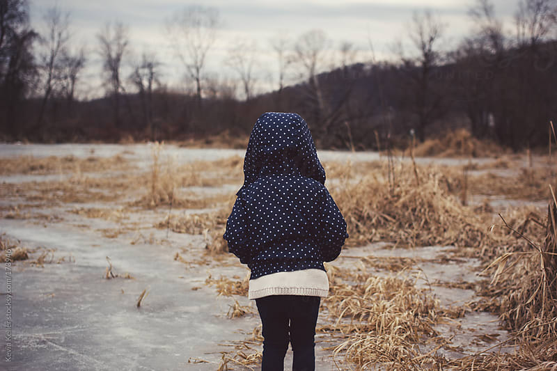 Toddler Girl Standing Outdoors on Ice  by Kevin Keller for Stocksy United