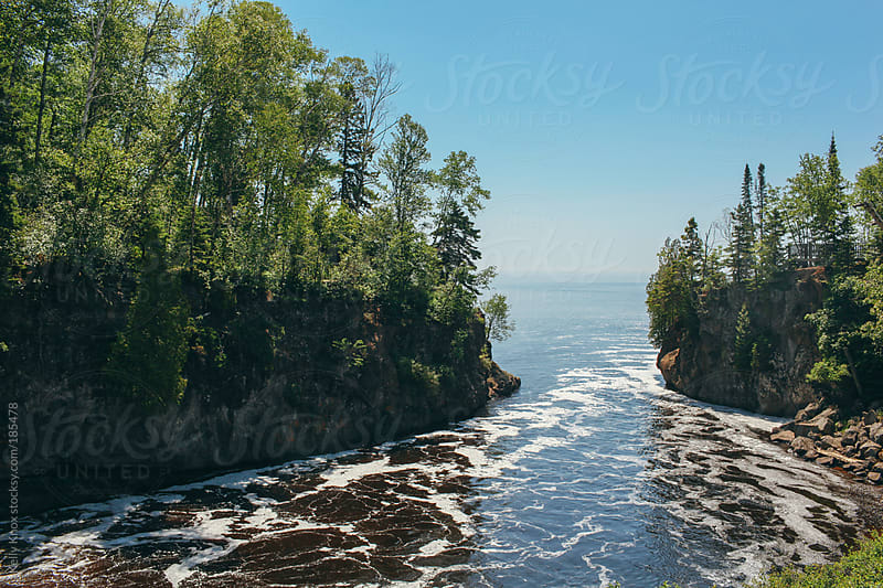 river opening up into Lake Superior by Kelly Knox for Stocksy United