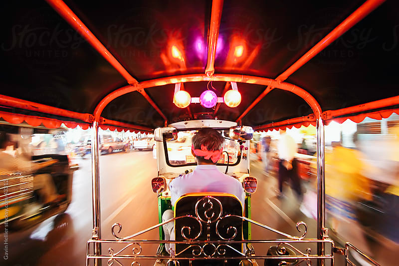Tuk Tuk or auto rickshaw in motion at night, Bangkok, Thailand, South East Asia by Gavin Hellier for Stocksy United
