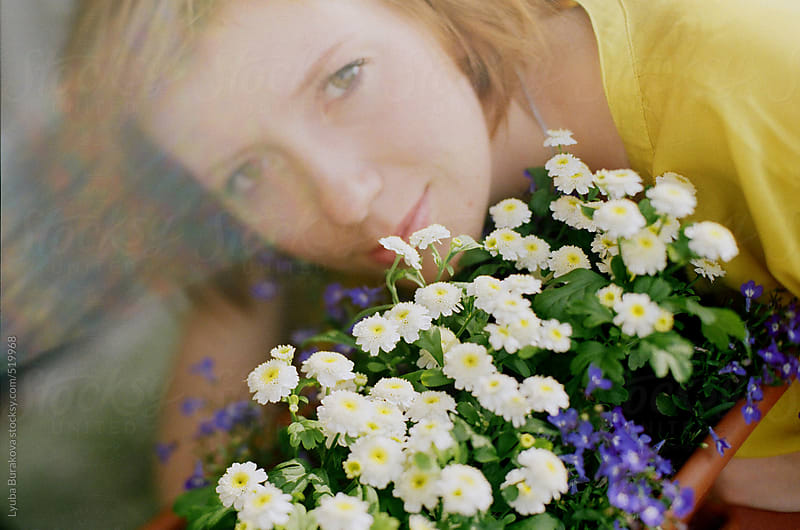 Close up portrait of young woman with flowers and rainbow by Lyuba Burakova for Stocksy United