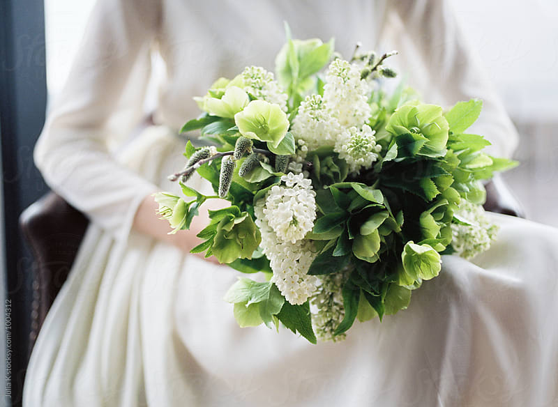 Spring bride's bouquet by Julia Kaptelova for Stocksy United