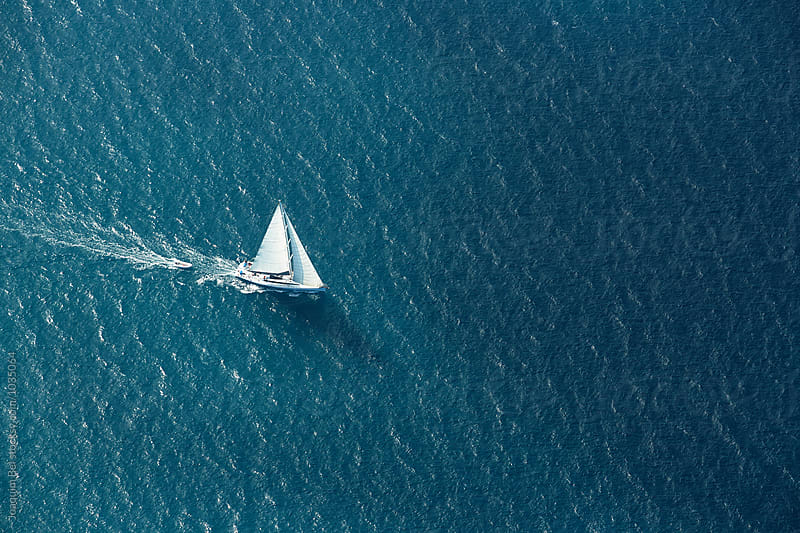 Boat alone in the sea by Joaquim Bel for Stocksy United