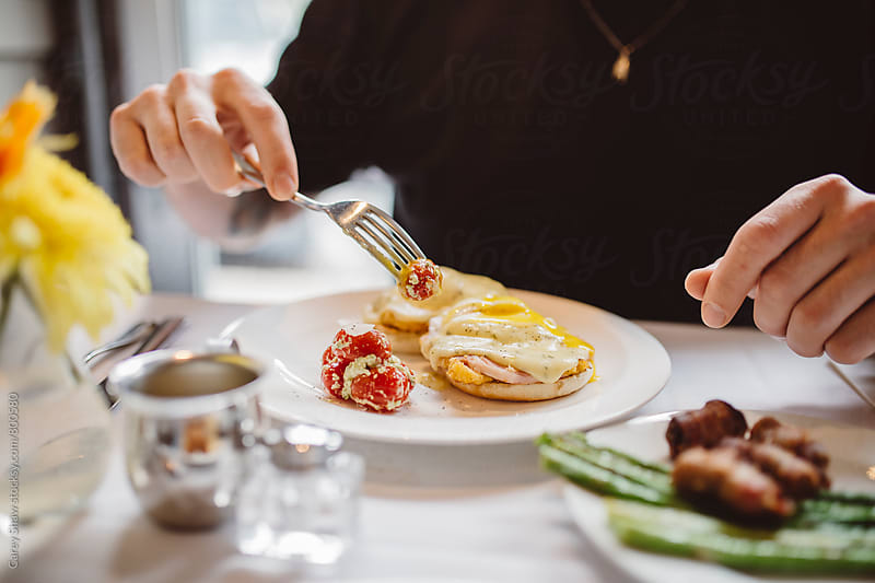 Man eating fresh breakfast by Carey Shaw for Stocksy United