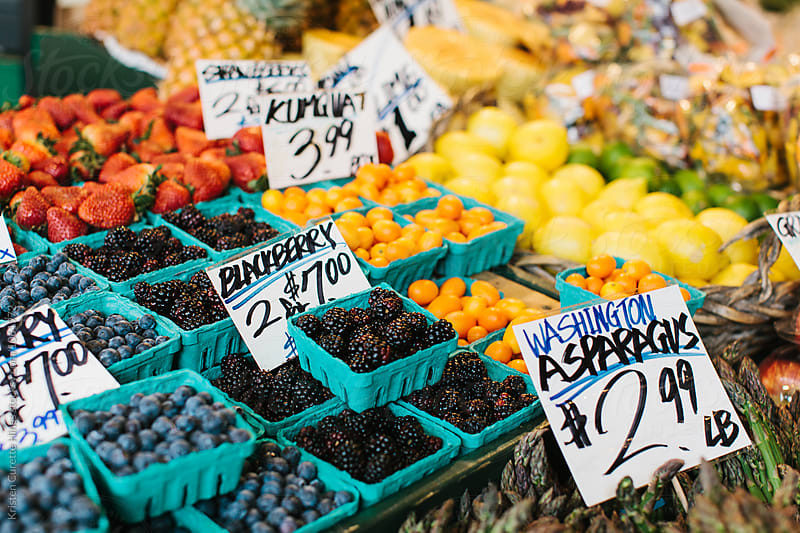 Fresh produce for sale at an outdoor market  by Kristen Curette Hines for Stocksy United