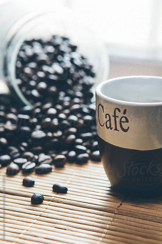 Cup of coffee and beans by Aleksandar Novoselski for Stocksy United