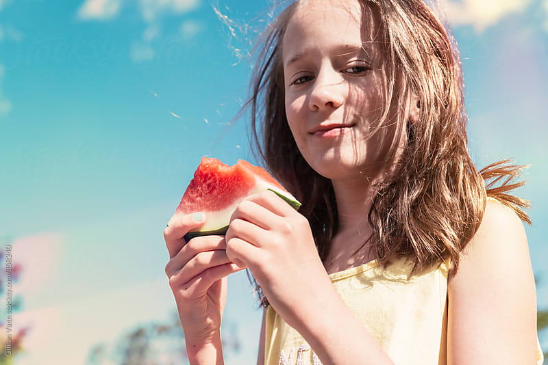 girl with watermelon, outside by Gillian Vann for Stocksy United