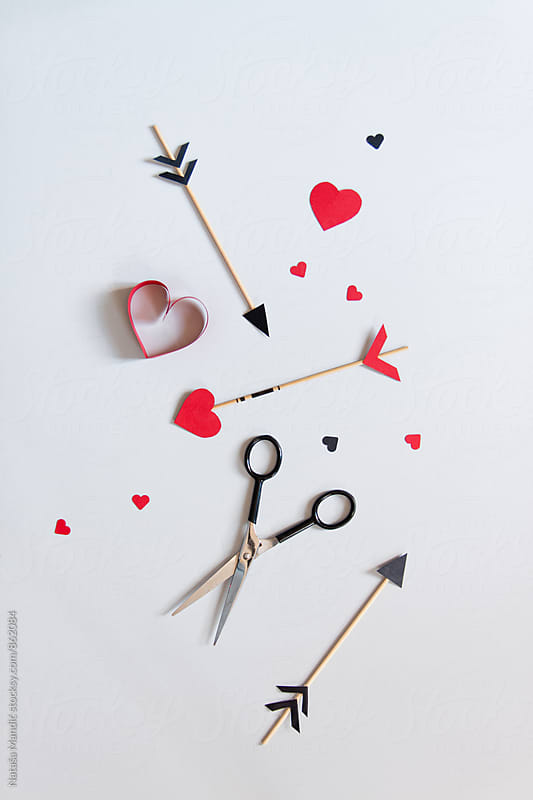 Arrows with heart shaped paper by Nataša Mandić for Stocksy United