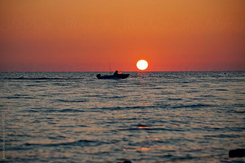 Sunset over the sea by Svetlana Shchemeleva for Stocksy United