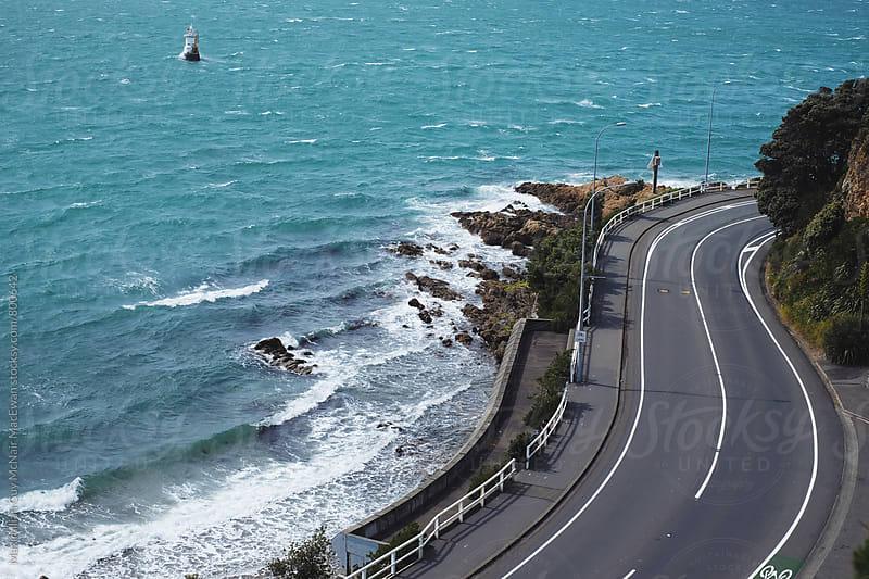A winding coastal road in Wellington, NZ by Maximilian Guy McNair MacEwan for Stocksy United