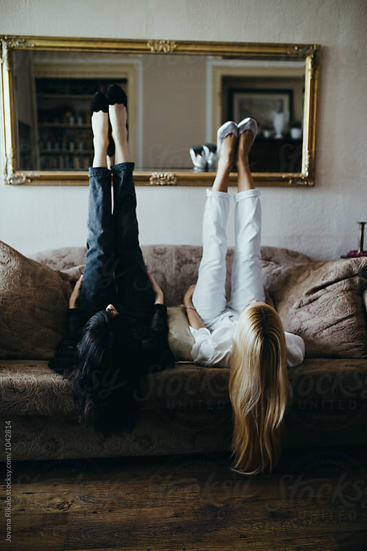 Artistic photo of a two fashionable young women by Jovana Rikalo for Stocksy United