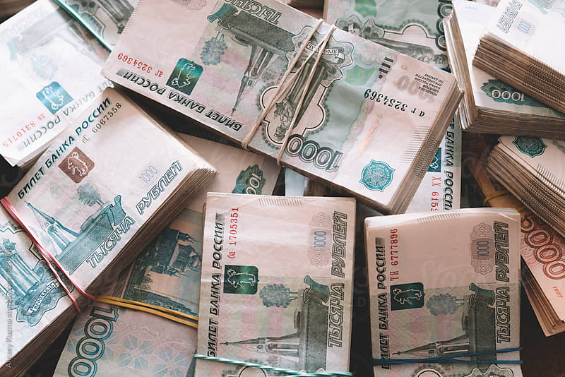 russian rubles. by Alexey Kuzma for Stocksy United