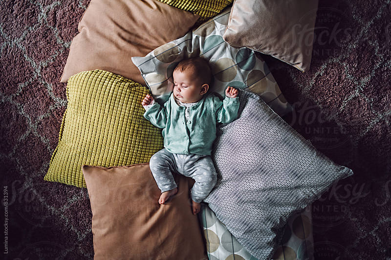 Baby Sleeping on the Pillows by Lumina for Stocksy United