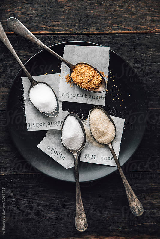 Food: Natural sugar alternatives, stevia, birch, coconut and full cane sugar by Ina Peters for Stocksy United