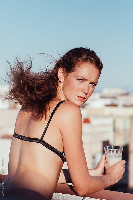 Beautiful woman on a Barcelona rooftop by Vera Lair for Stocksy United
