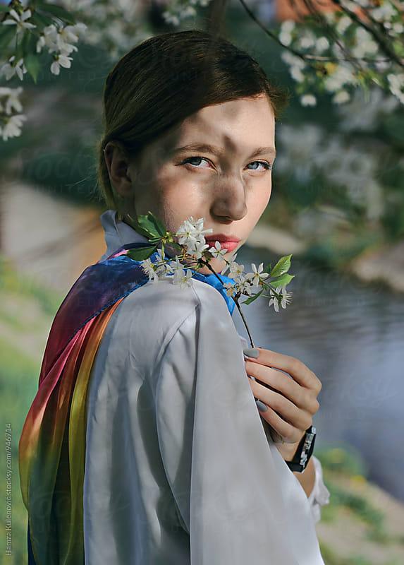 Portrait of a girl taken under the tree by Hamza Kulenović for Stocksy United