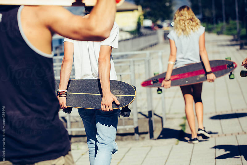 Group of skaters holding their skateboards by michela ravasio for Stocksy United