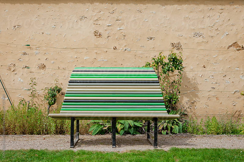 Green bench in a park by Christine Love Hewitt for Stocksy United