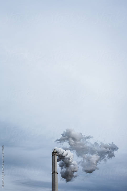 Thick smoke rising from the chimney factory by Mauro Grigollo for Stocksy United