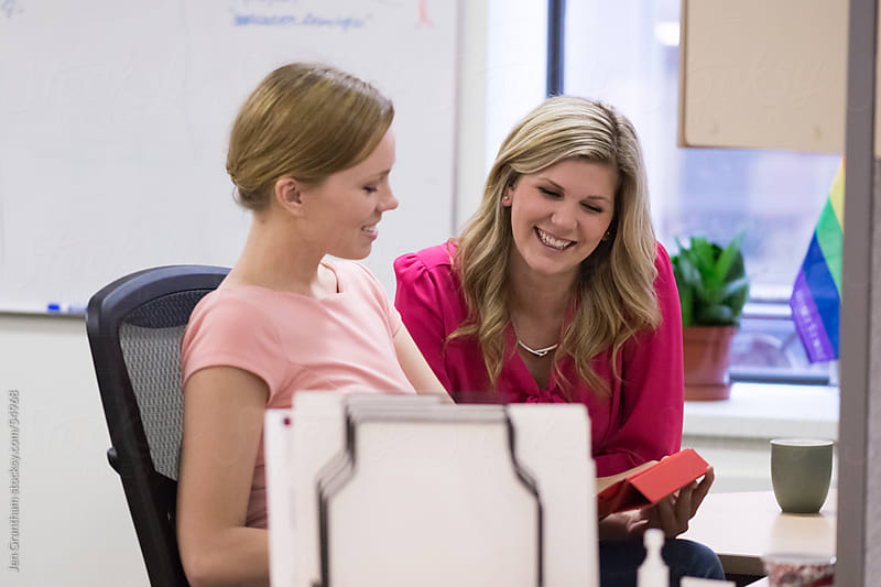 Female employees working with digital tablet by Jen Grantham for Stocksy United