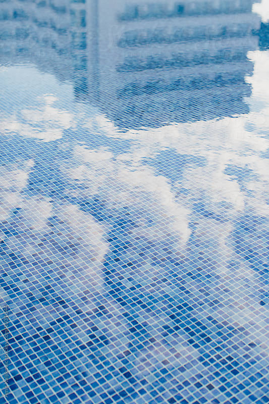 Abstract monochrome blue reflection of a hotel by Amir Kaljikovic for Stocksy United