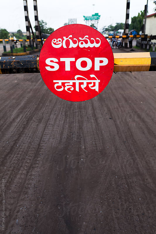 STOP written in Railway crossing by PARTHA PAL for Stocksy United
