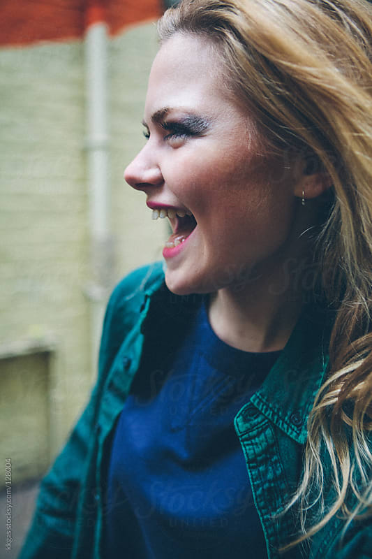 Laughing blonde woman by kkgas for Stocksy United