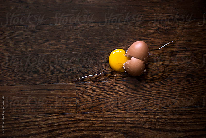 Broken egg that's been dropped on the kitchen floor by Cara Slifka for Stocksy United