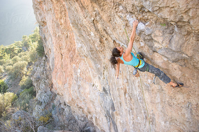 Strong woman rock climbing a steep wall by RG&B Images for Stocksy United
