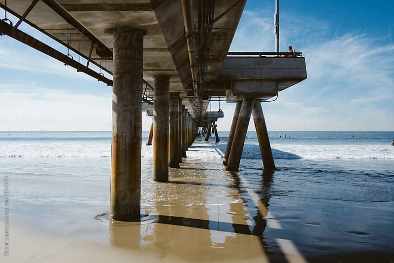 California pier on sunny day by Oscar Lopez for Stocksy United