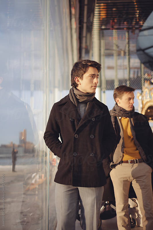 Young Men Friends Waiting for their Date in Dumbo Brooklyn by Joselito Briones for Stocksy United