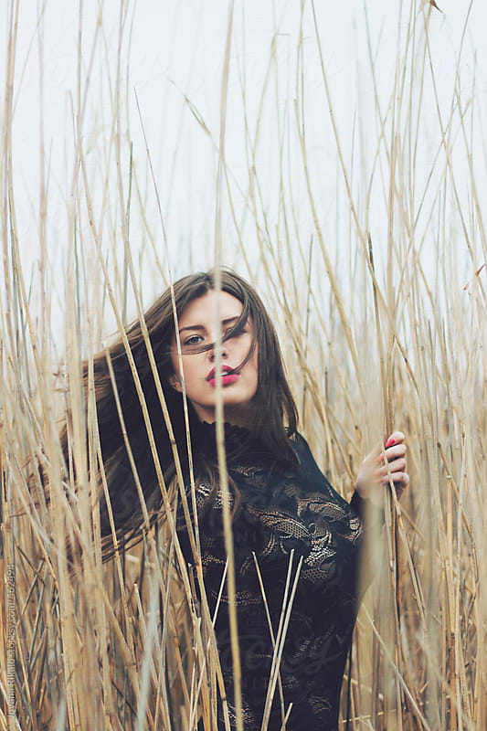 Beautiful young woman in grass meadow by Jovana Rikalo for Stocksy United
