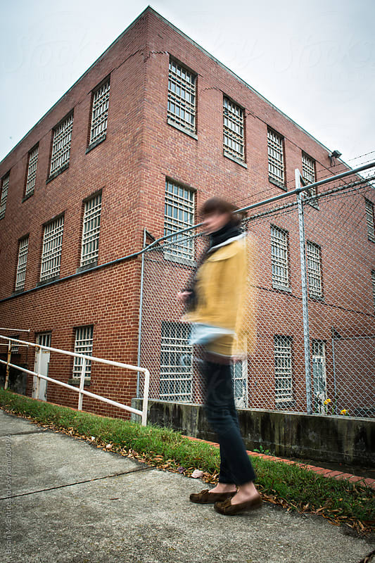Urban Woman Touring Abandoned Psychiatric Building by Brian McEntire for Stocksy United