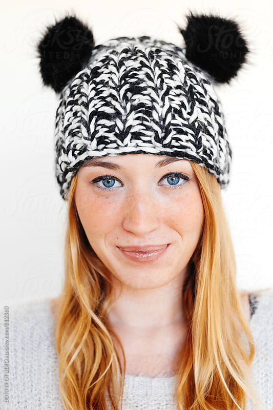Portrait of a blonde woman wearing a funny wool hat. by BONNINSTUDIO for Stocksy United