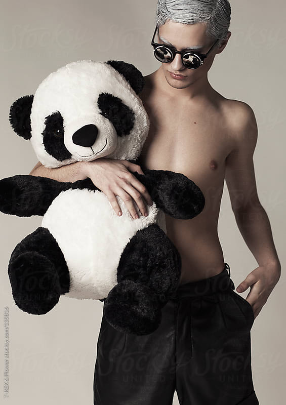 Young man with panda toy by T-REX & Flower for Stocksy United