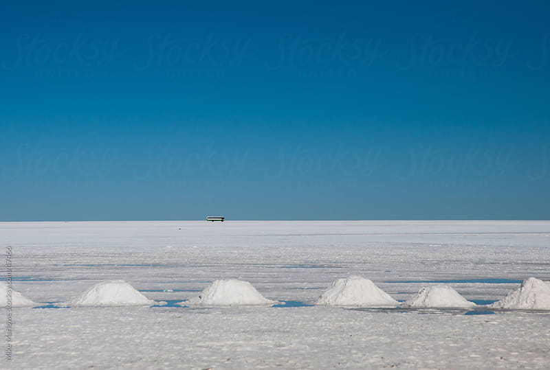 A bus on the salt flats in Bolivia by Mike Marlowe for Stocksy United