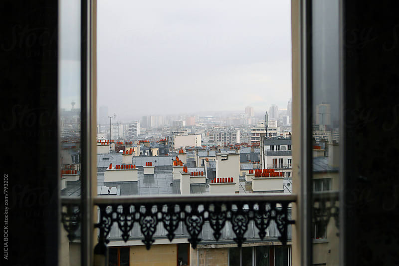 Out A Window At The Rooftops Of Paris France On A Cloudy Day by ALICIA BOCK for Stocksy United